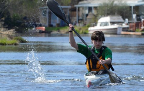 Jupiter Grant focuses on his paddling. He often practices kayaking in the Sammamish River near Bothell Landing Park.