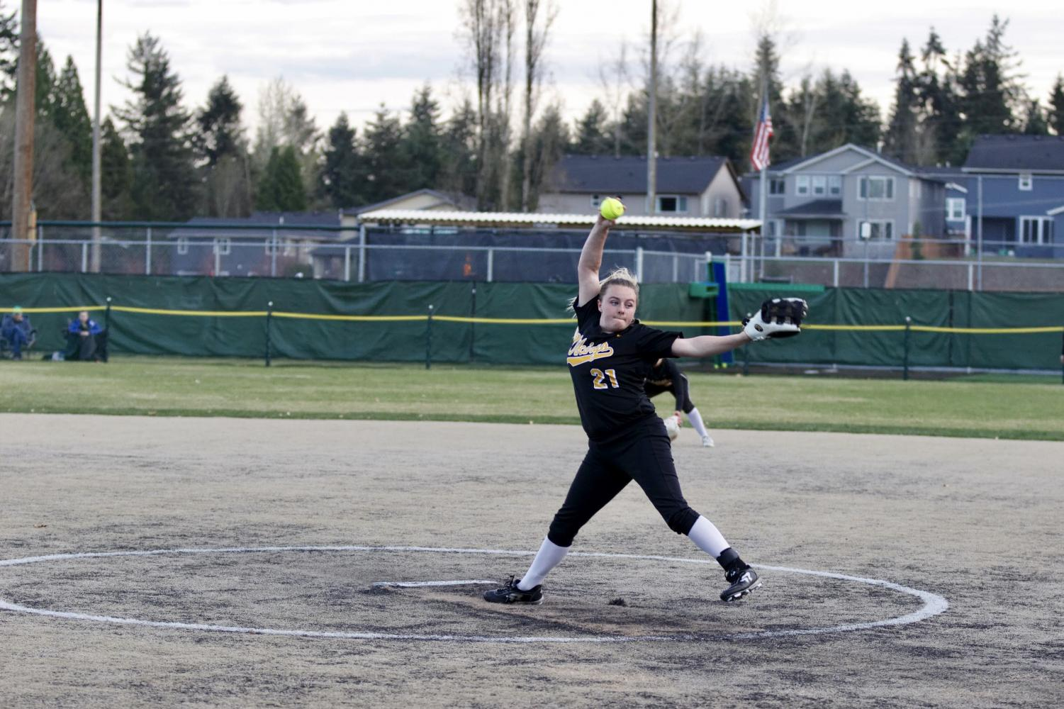 Pitcher Taylor Waara fires a pitch across the plate against the Woodinville Falcons. The girls lost a low scoring game, falling to the Falcons 2-1 on April 1st.