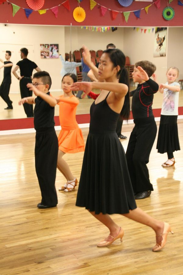 Anzu Yonezawa rehearses at her tri-weekly ballroom dance lesson at the Aria Ballroom. Although she is currently just a beginner, Yonezawa said that she is taking private lessons right now and hopes to level up to bronze soon.