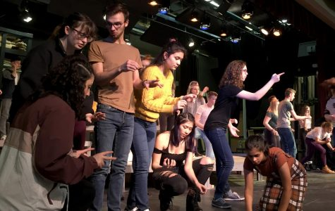 "The cast of ""Working"" rehearse the song ""All the Livelong Day,"" acting as everyday citizens. While some cast members have a more specific role, during large ensemble pieces the whole cast works together as to create a choreographed scene. Pictured is Serrein Sabbah, Taylor Reddick, Hunter Essex, Malu Rivera, Briza De La Cruz, Julia Owens and Akhila Narayanan."
