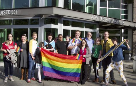 Members of Northshore Pride (NSP) pose with rainbow flags outside of the Northshore Administrative Center, following the School Board Meeting on Monday, May 13. The group was joined by many other LGBT+ community members and allies, who informed the School Board of why they believe representation and education in schools is important.
