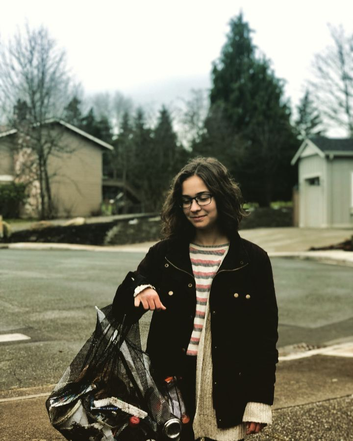 Quinn Rector holds up a bag of trash she collected outside of Bothell High School during one of her many trash walks.