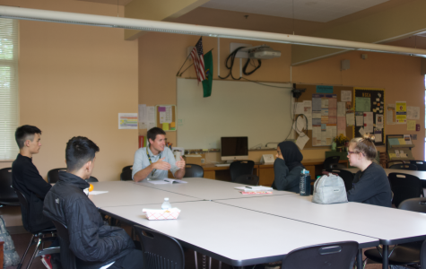 Principal Adam Desautels speaks with students at a preliminary Climate Board meeting on May 14. From left to right: Owain Waszak, Jayden Estevez, Rahima Baluch and Ashley Egger.