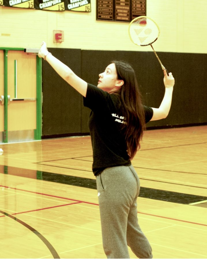 Senior Angela Clemens, who has been playing badminton since her sophomore year, hits overhand during badminton practice on April 30 for their KingCo game on May 1.