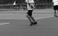 Adam Walter makes a racket on the tennis courts