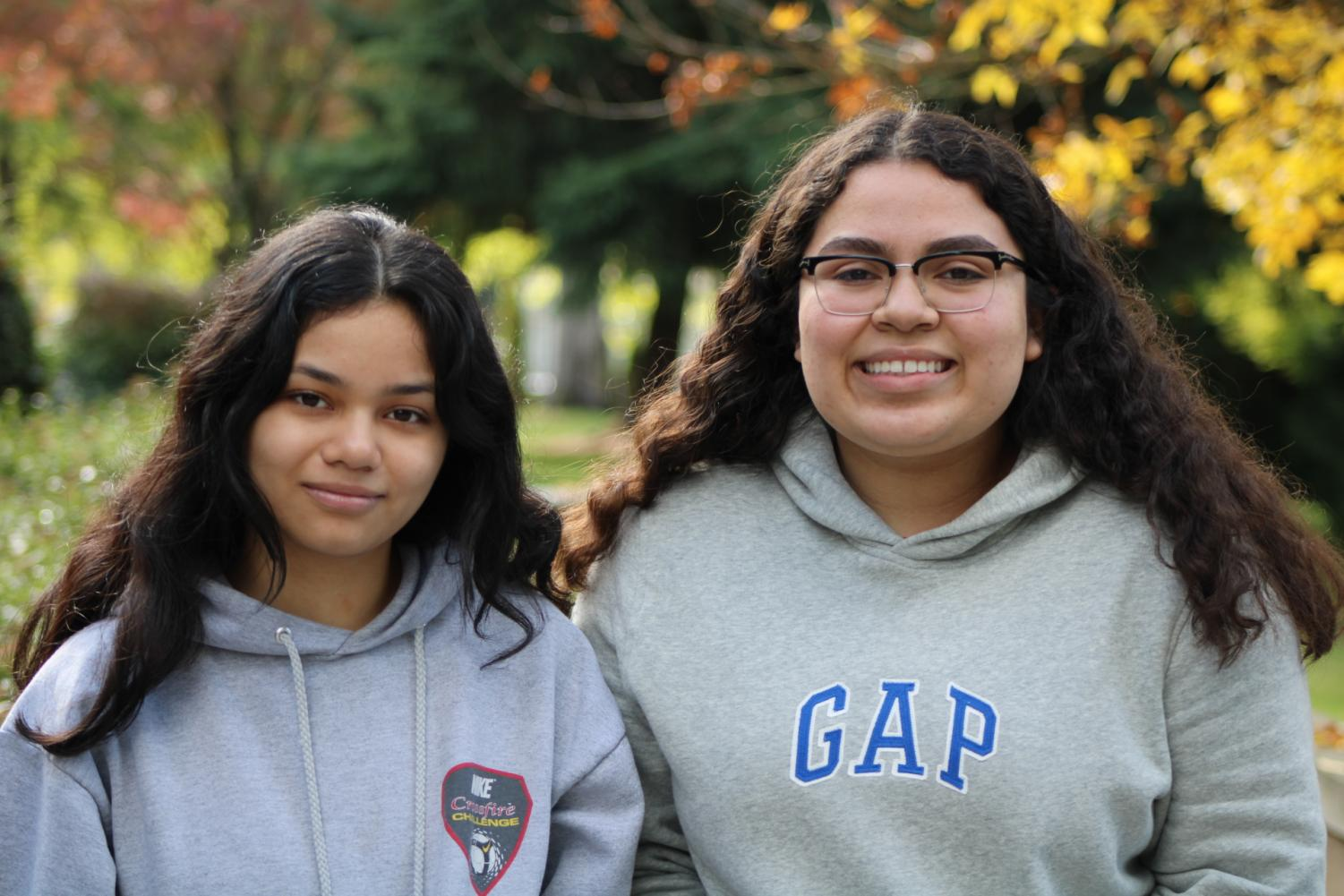 Sophomore Jimena Alarcon (left) and senior Vanessa Morales (right) pose for a picture outside of Inglemoor.