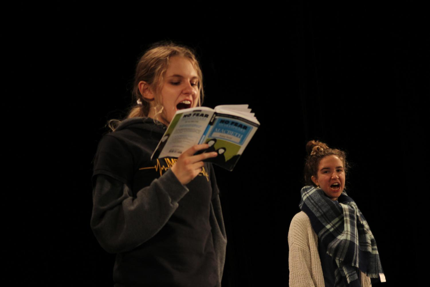 "Junior Daisy Held reads lines at an after-school rehearsal of ""Macbeth."" Photo by Eli Shafer"