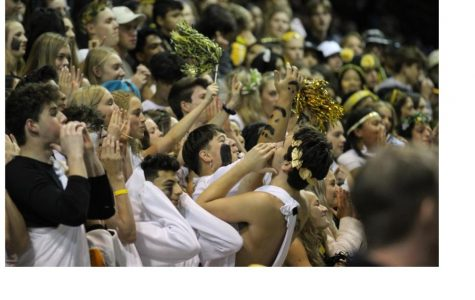 The ASH group in the front of the stands, cheering on the football team. Photo by Rory Knettles