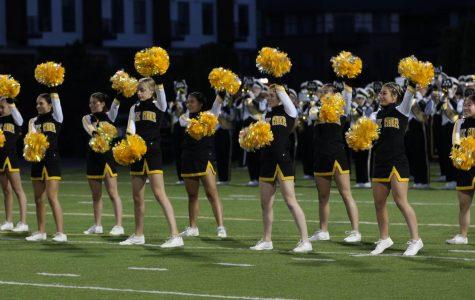 Cheerleaders adapt to change as winter season approaches