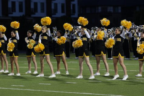 Cheerleaders adapt to change as winter season approaches