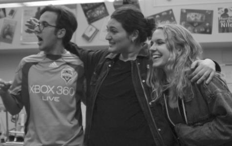 Senior Sam Trott, junior Lizzy Guyer and junior Daisy Held laugh together during improv practice.