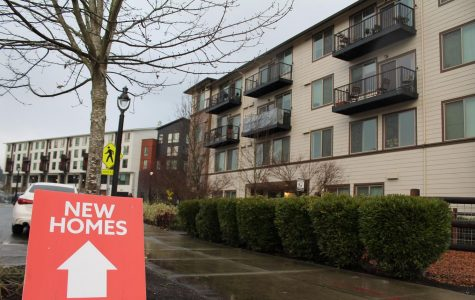 Downtown Bothell sign advertises real estate available at The Landing townhome complex on Dec. 15. Photo by Sofia Leotta