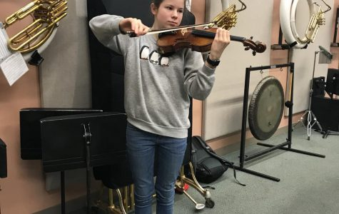 Freshman Haley van Meurs shows off her skills in the band room on Dec. 16. Photo by Sonya Sheptunov
