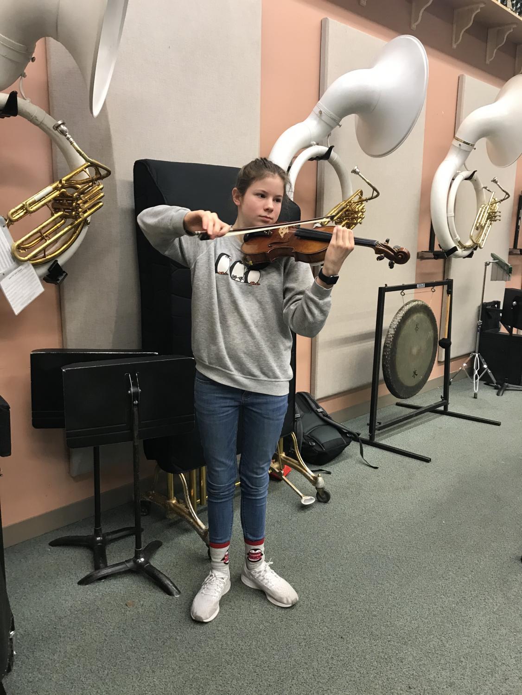 Freshman Haley van Meurs shows off her skills in the band room on Dec. 16. Photo by Sonya Sheptunov