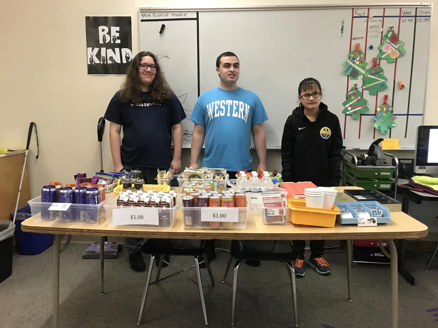 Senior Lucca Gusmao, junior John Pakkala and freshman Verada Ellet just opened the store for Monday, Dec. 16 during break. Gusmao's role is to take inventory of the store, which he said he enjoys. Photo by Aditi Jain