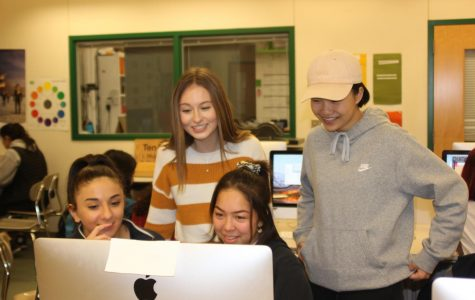 Juniors Anita Macagno, Tenny Larsen, Jessica Carbaugh and Sophia Zeng (Left to right) collaborate on a page layout. The team works on an upcoming publishing deadline. Photo by Rory Knettles