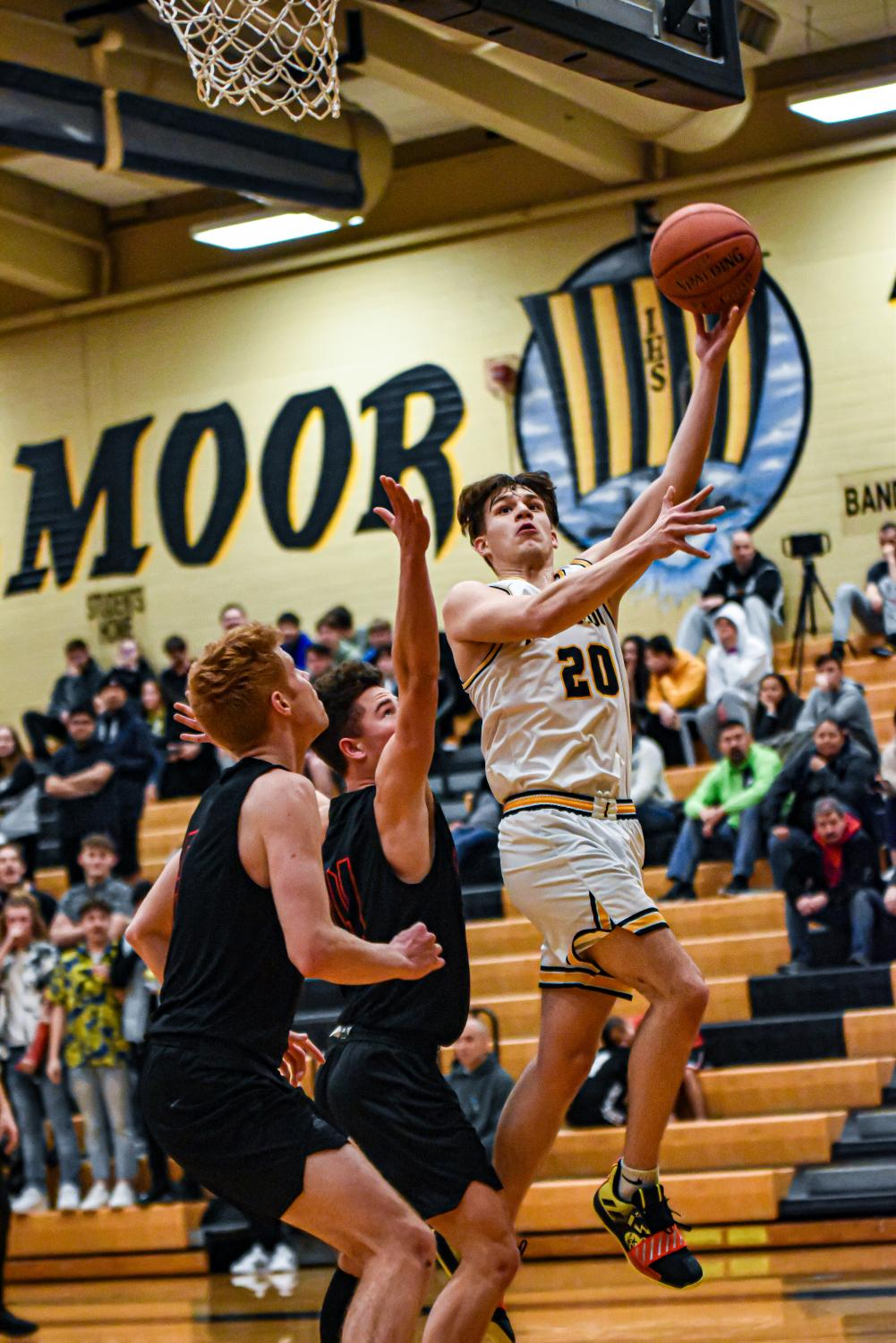 Senior Brady Casto shoots a basket in the Inglemoor gym  on many afternoons against other high schools. Photo cour- tesy of Evan Morud