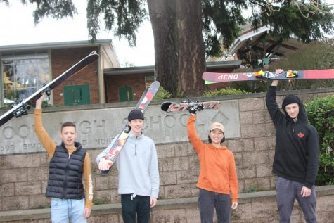 Junior Seth Rigor, senior Dane Loucks, junior Sophia Zeng, and junior Lorenzo Pasinelli (left to right) all hold up their skies in front of Inglemoor High School on Jan. 30. Photo by Nathan Guest