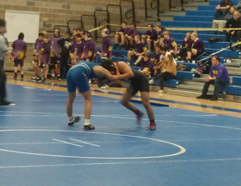 Sophomore Sinue Geniz-Hernandez wrestles a Liberty High School athlete at Bothell High School on Jan. 23. Photo by Caden Pavlovski