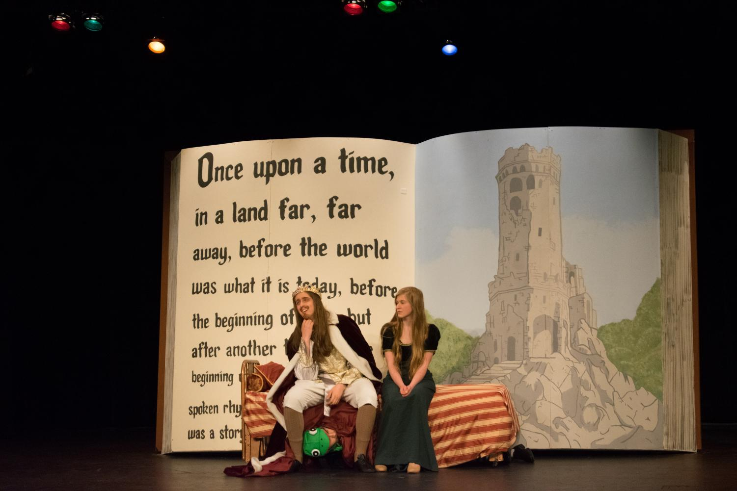 Seniors Ya'am Zahavy Mittelman and Owain Waszak and sophomore Gabi Kotwicki (left to right) play the King, the Frog Prince and the Princess respectively. The King gives his daughter romantic advice while the Frog Prince hides underneath the bed on Jan. 25. Photo by Cathy Zhao