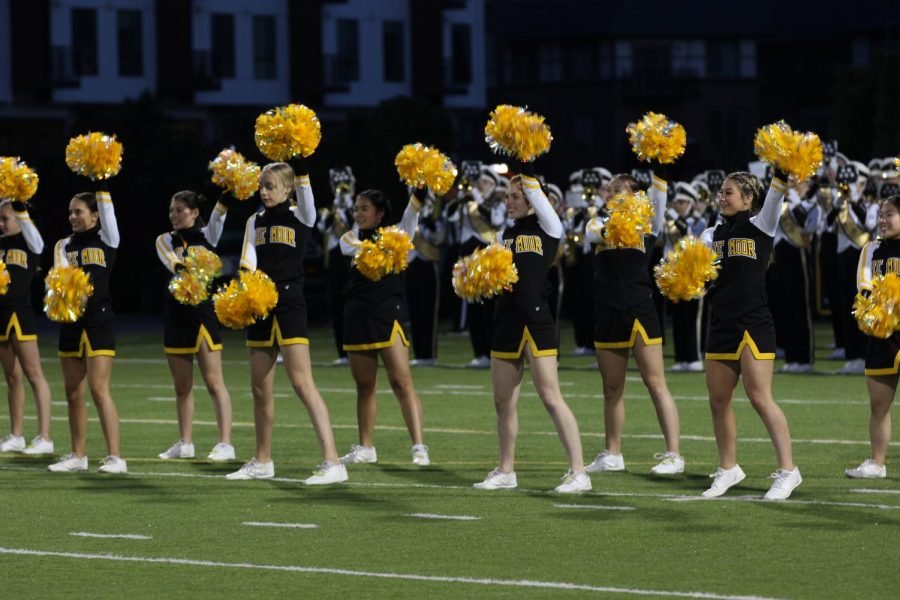Cheerleaders face the crowd to get them pumped for the gameon Oct. 12 . Photo by Eli Shafer