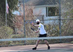 Senior and fourth singles player Daniel Orr winds up for a forehand during his match against Woodinville. Orr went on to win both sets, with scores of 6-2 and 6-0. Photo courtesy of Jim Orr.