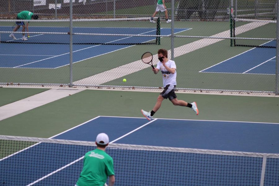 3rd doubles player Cosmo Anthony-Mostad hits a forehand during the Woodinville match. The match was lost after a close tiebreak, ending 6-2, 2-6, and 7-10. Photo courtesy of Jim Orr.