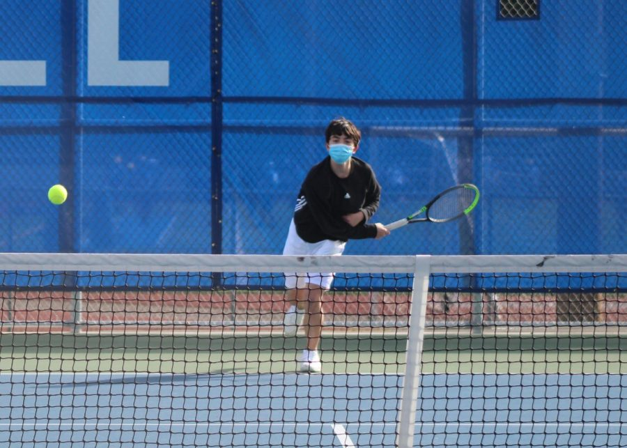 Caption for photo: Third singles player and freshman Charles Wait serves the ball. Wait went on to win his match 6-0, 6-0. Photo Courtesy of Jim Orr.