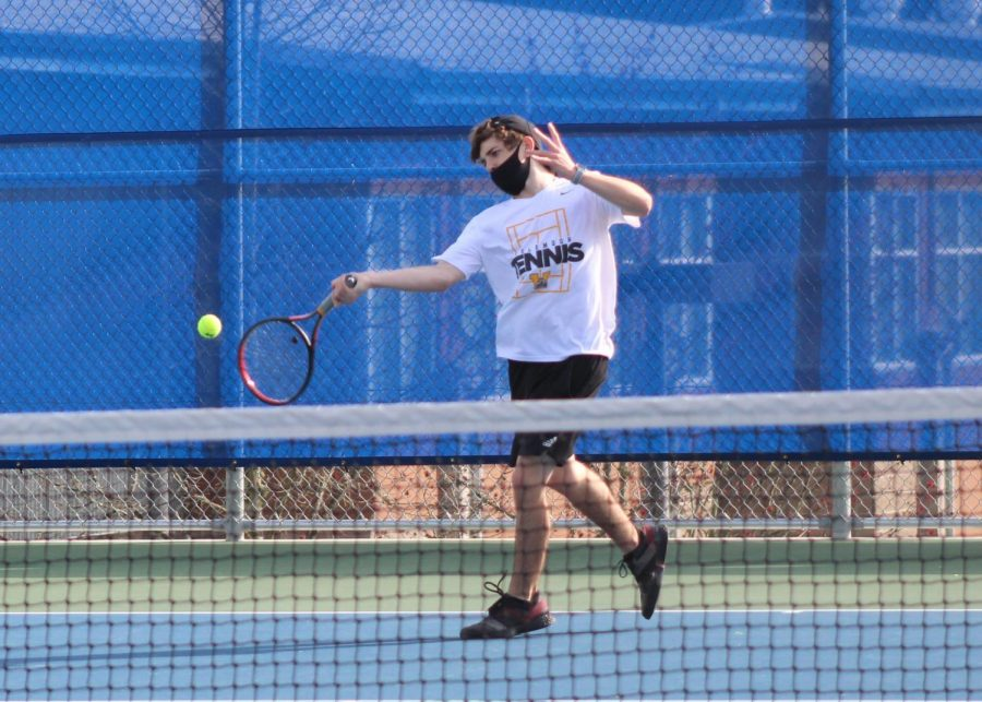 Senior and first singles player Adam Walter prepares for an underhand shot during his match against Bothell. Photo courtesy of Jim Orr.
