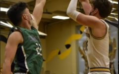 Senior Nick Smith shoots a fadeaway against Woodinville on Thursday, Apr. 20. Photo by Tam Tran.